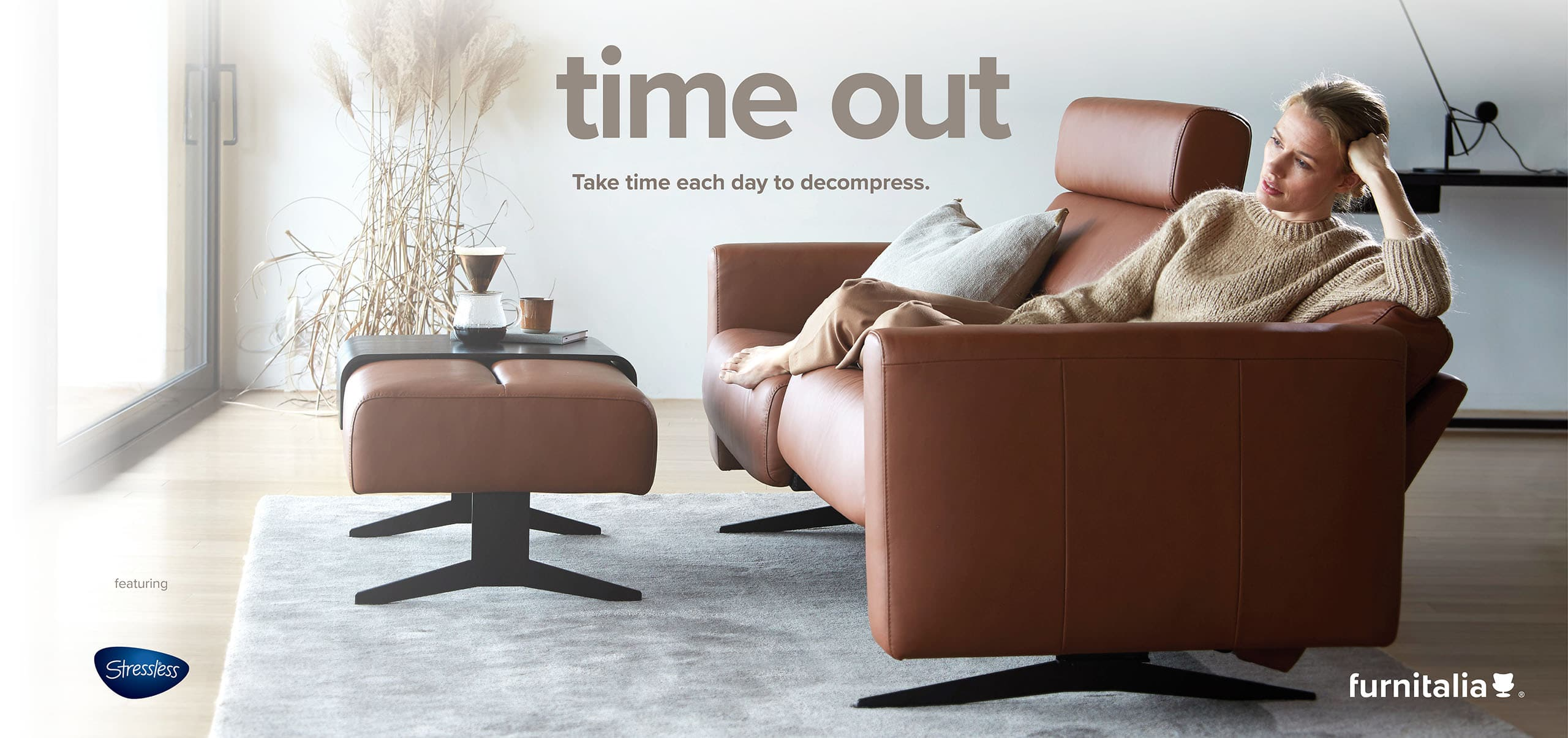 Enjoy modern contemporary home furniture like this sofa and ottoman from Stressless®.